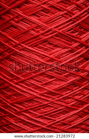 Threads densely reeled up on the coil - stock photo