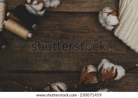 Threads with cotton flower on the table - stock photo