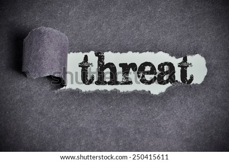 threat word under torn black sugar paper  - stock photo