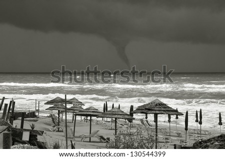 threatening waterspout on the sea - stock photo