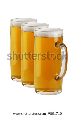 Three a glass beer mugs with beer. Objects over white