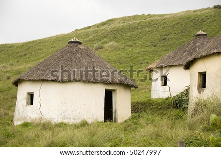 Three abandoned rural huts in South Africa - stock photo