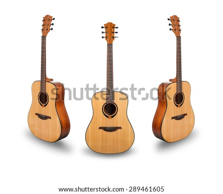 Three acoustic guitar with shadow over white background - stock photo