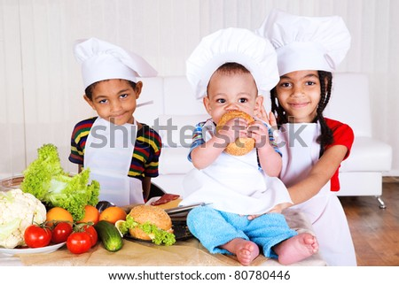 Three african american kids cooking - stock photo