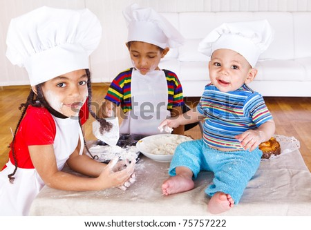 Three african american kids playing with flour - stock photo