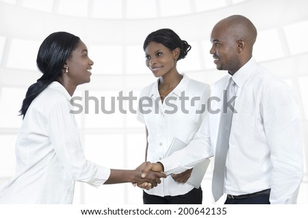 Three african business partners shake hands, Studio Shot - stock photo