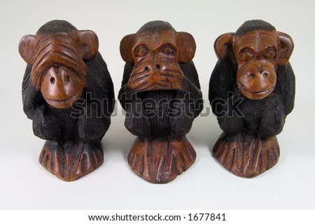 Three African statuettes of wise monkeys that see no evil, speak no evil and hear no evil.