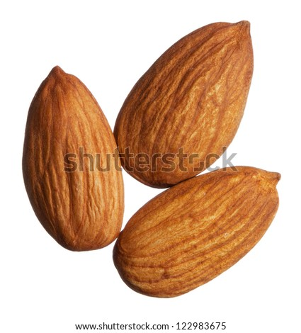 Three almonds isolated on white background - stock photo