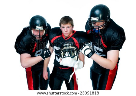 Three American football players - stock photo