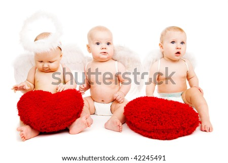 Three angelic baby friends with red hearts - stock photo