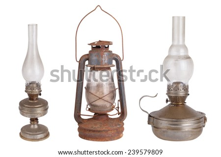 Three antique kerosene lamps isolated on white background  - stock photo