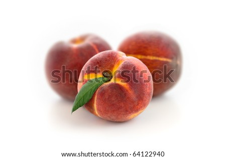 Three appetizing peaches - stock photo
