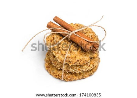 Three apple crackers tied decorative rope and decorated with cinnamon on a white background - stock photo