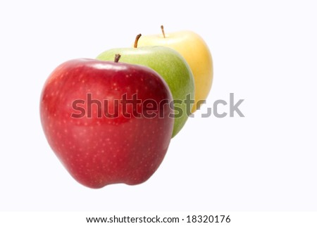 three apples red yellow and green on white background short focus