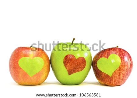 Three apples with hearts - stock photo