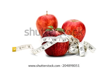 Three apples with measuring tape - stock photo