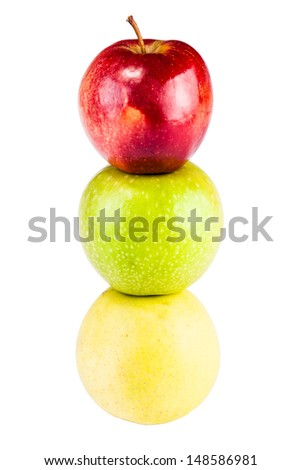 three apples (yellow, green and red) isolated over a white background - stock photo
