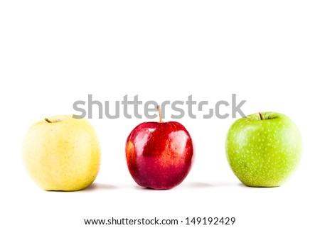 three apples (yellow, green and red) isolated over a white background