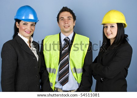 Three architects teamwork standing in a line and smiling for you in front of blue background
