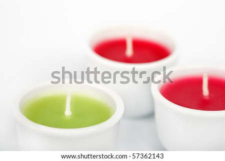 Three aromatic candles on white background - stock photo