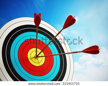 Three arrows at the center of the target. - stock photo