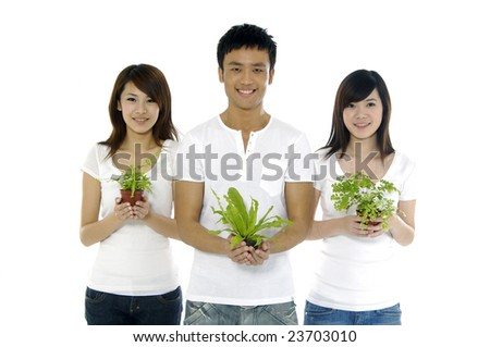 Three asian man holding a growing plant - stock photo
