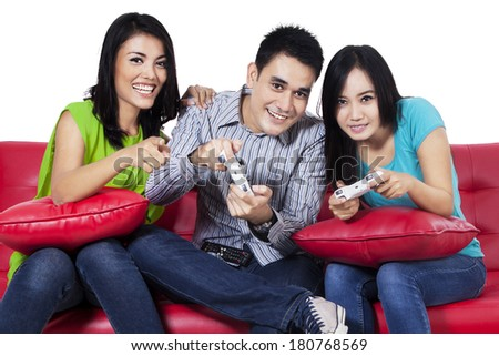 Three asian teenagers playing video games