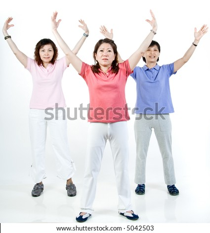 Three Asian women working out together in the studio - stock photo