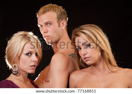 Three attractive blond caucasian man and women