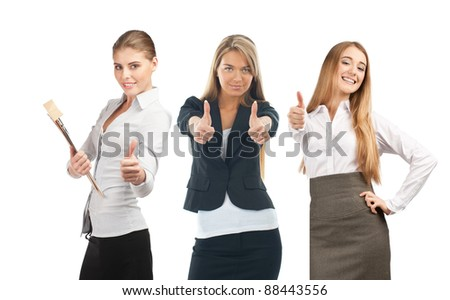 Three attractive business women showing thumbs up and smiling. Isolated on white background - stock photo