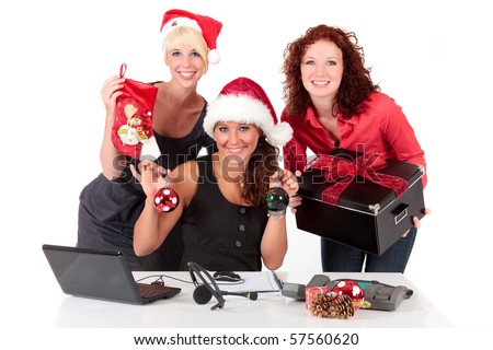 Three attractive businesswomen ready with gifts for a  Christmas party  in the office. Studio shot. White background