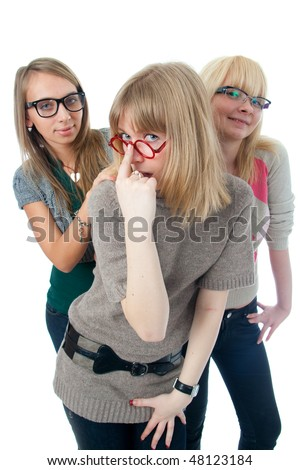 Three attractive girls isolated on a white background