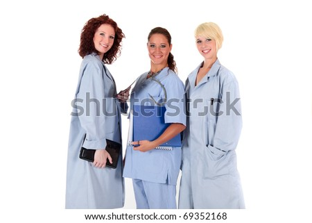 Three attractive mature female doctors dressed in uniforms. Studio shot. White background