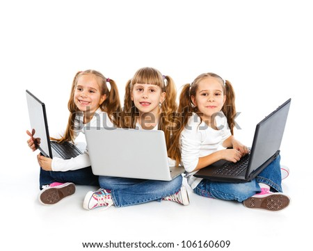 Three attractive sisters (triplets) using a laptop. Isolated on white background