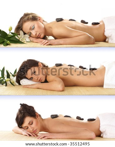 Three attractive women getting spa treatment isolated on white - stock photo