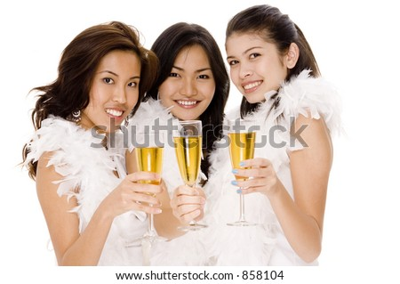 Three attractive young asian women drinking champagne
