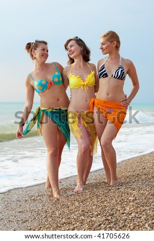 Three attractive young women at the sea