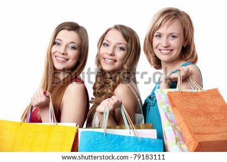 Three attractive young women with bag isolated - stock photo