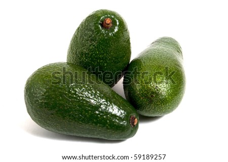three avocados isolated on white background - stock photo