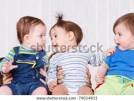 Three babies communicating - stock photo