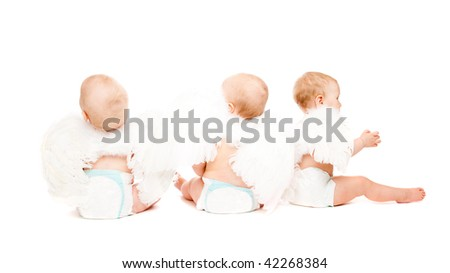 Three baby angels sitting with their backs to the camera - stock photo