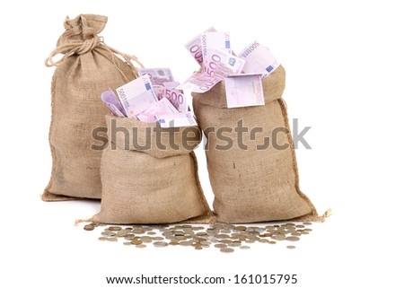 Three bags with many euro banknotes. Isolated on a white background. - stock photo