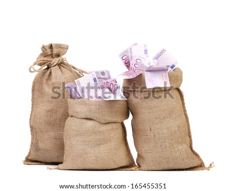 Three bags with many euro banknotes. Isolated on a white background.