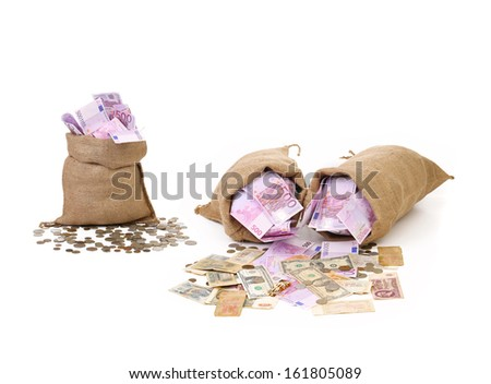 Three bags with much money. Isolated on a white background - stock photo