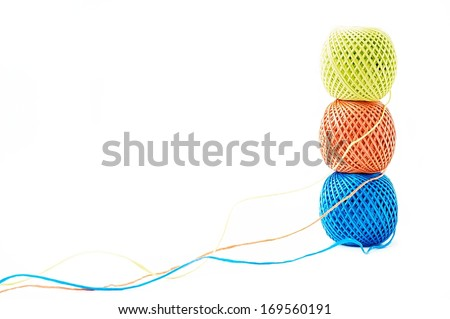 Three  balls of twine on a white background - stock photo