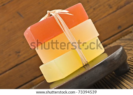 Three bars of organic glycerin soap in a spa. - stock photo