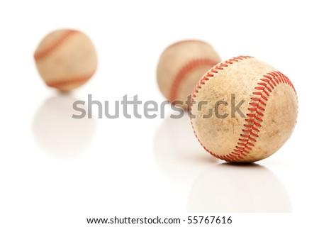 Three Baseballs Isolated on a Reflective White Background. - stock photo