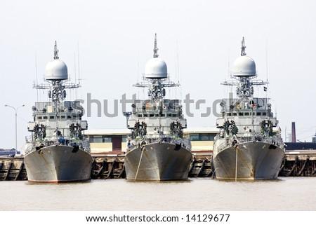 Three battleships docked in port - stock photo