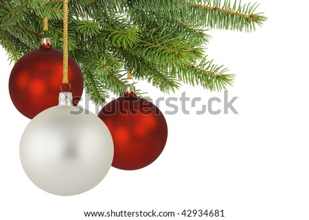 Three baubles hanging on a spruce branch. - stock photo