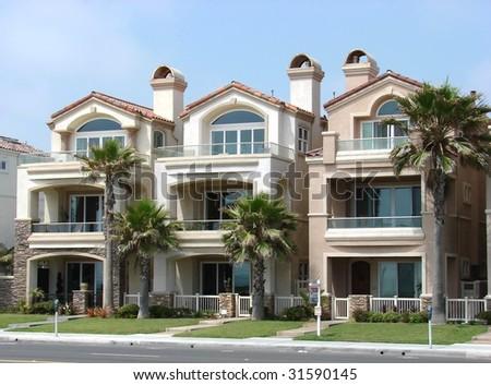 three beach houses - stock photo